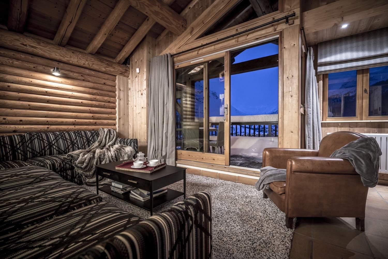 Cristal B - séjour canapé fauteuil balcon